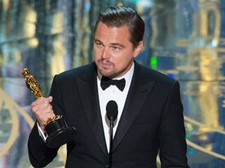 A gracious Leonardo DiCaprio gets his Oscar, acknowledges climate change in speech